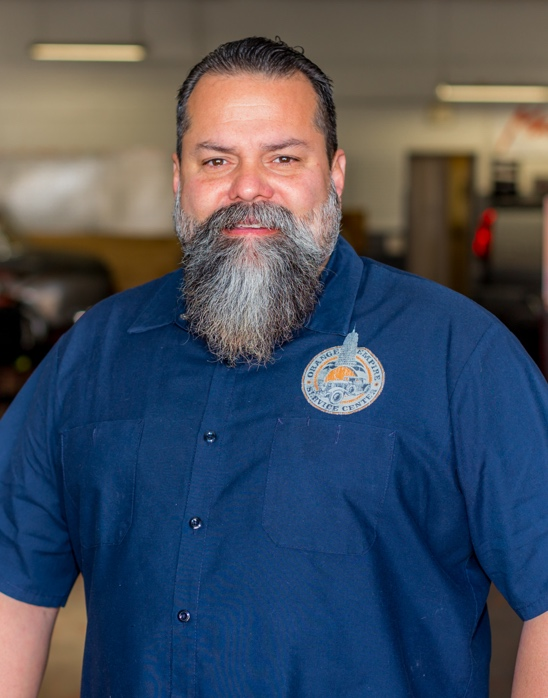 Omar G, Auto Repair Shop Owner, smiling proudly
